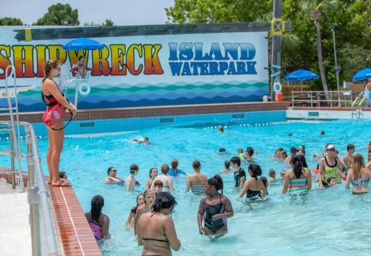 a water pool, a lazy river, and play areas for kiddies
